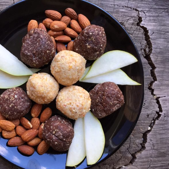 Cashew & Apricot Protein Balls with almonds & pear slices on a serving plate