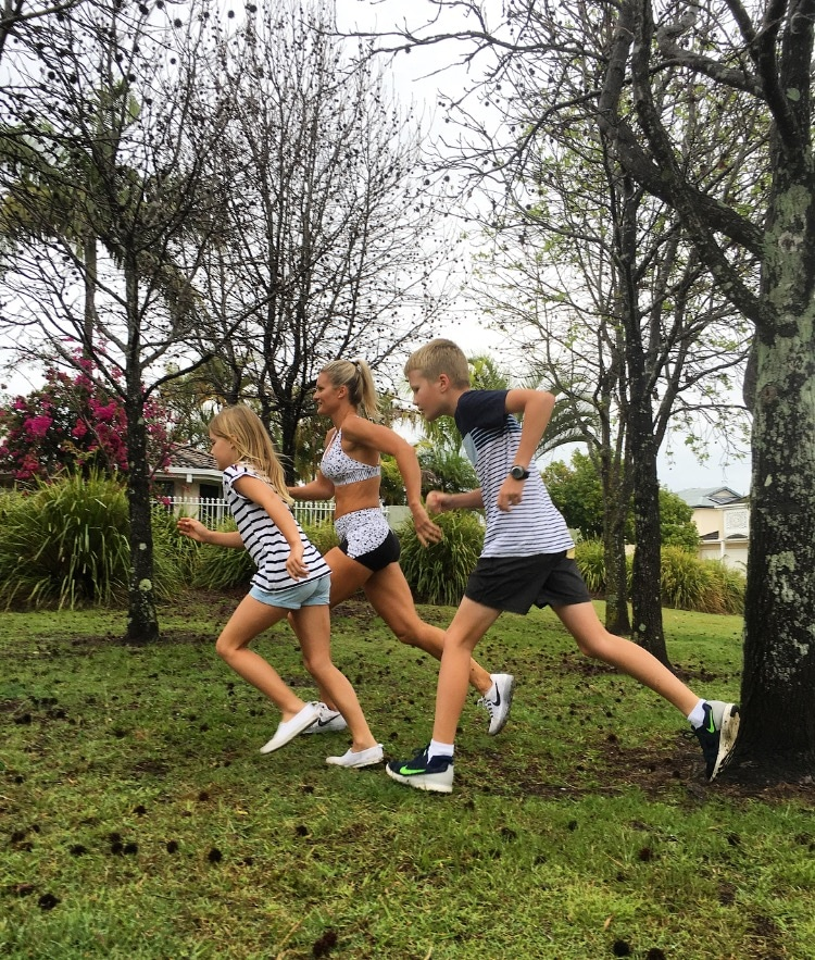 Belinda Norton Smith running with two children